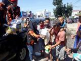 Pemuda Pancasila Berbagi Beras kepada 200 Jukir dan Pedagang Asongan
